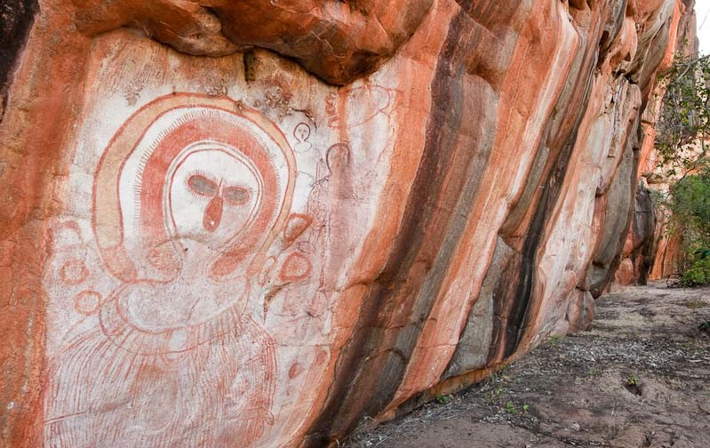 AUSTRALIA, Western Australia, West Kimberley. Wandjina (creator beings), rock art style painted during last 4000 years, in rock shelter on Bachsten Creek. @Grant Dixon Photography