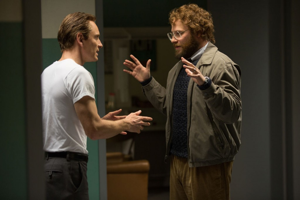 "In this image released by Universal Pictures, Michael Fassbender, left, as Steve Jobs, and Seth Rogen as Steve Wozniak, appear in a scene from the film, ""Steve Jobs."" The movie releases in U.S. theaters on Friday, Oct. 9, 2015. (Francois Duhamel/Universal Pictures via AP)"